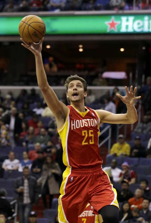 Rockets forward Chandler Parsons tries a lay-up.