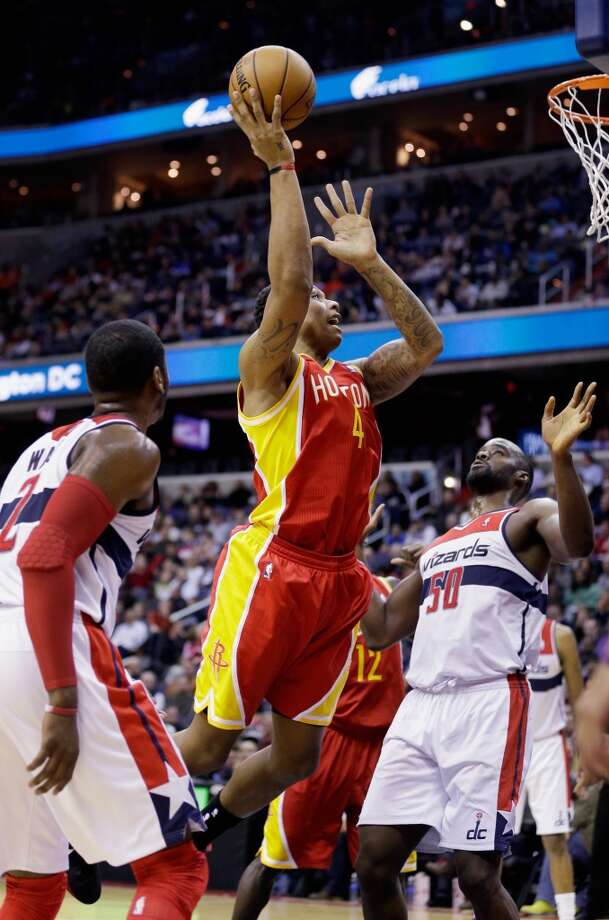 Greg Smith of the Rockets puts up a shot in front of John Wall.