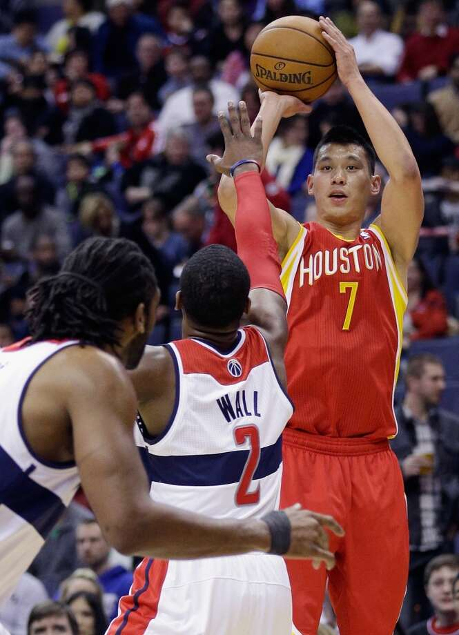Jeremy Lin shoots over the defense of John Wall.