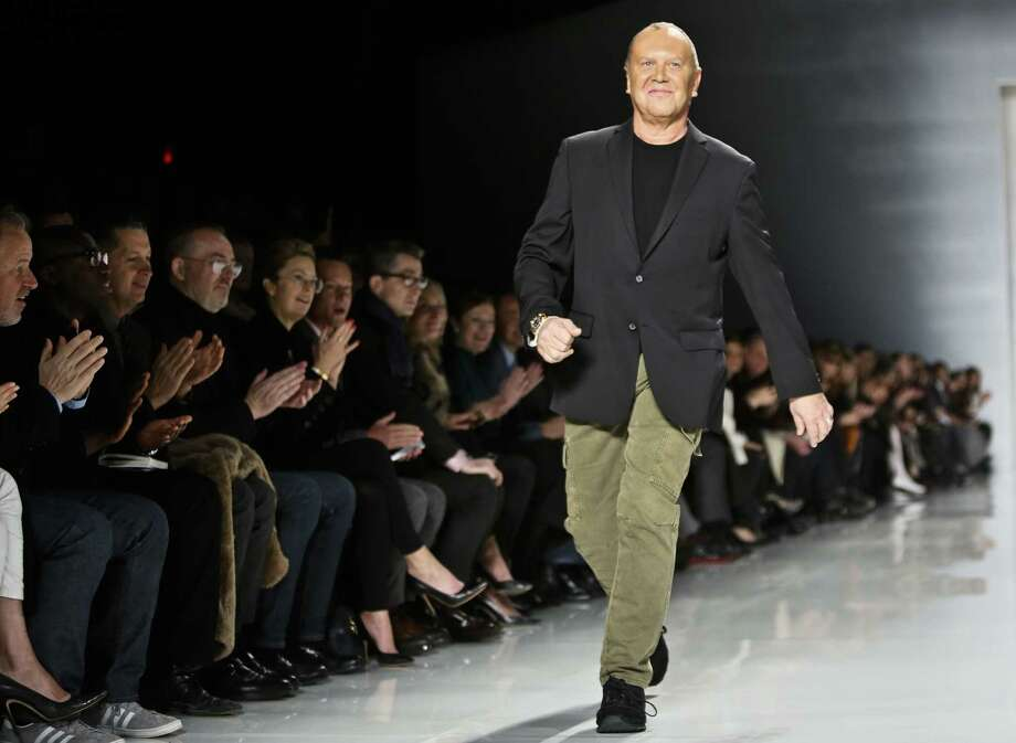 Fashion designer Michael Kors has sold about 17 million shares of stock since Michael Kors Holdings went public. Thursday, he sold about 3 million shares. Photo: Bebeto Matthews / Associated Press