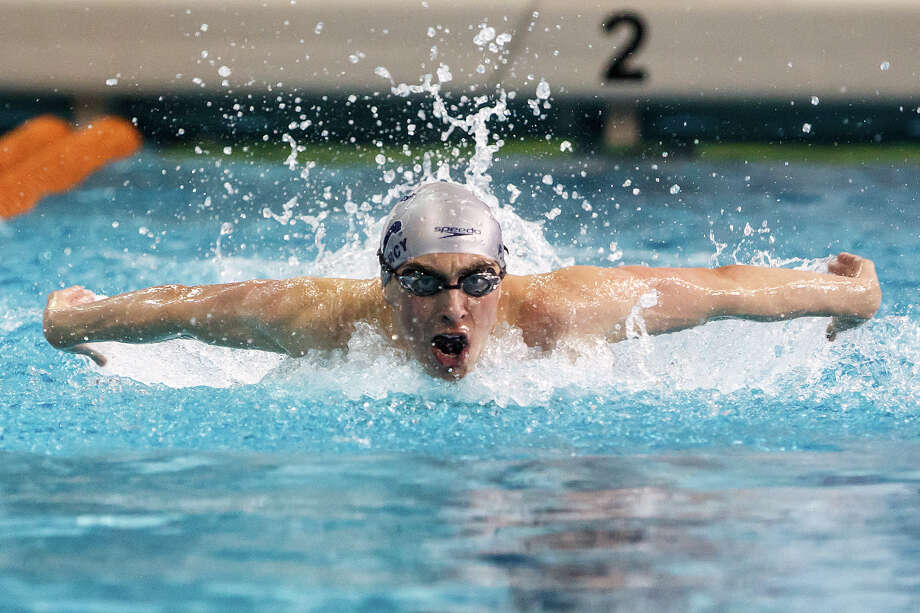 Boerne Champions' Prescott Marcy swims to silver in the boys 100 yard butterfly in the finals of the 4A UIL Swimming & Diving State Meet at the Jamail Texas Swim Center in Austin on Saturday, Feb 23, 2013.  MARVIN PFEIFFER/ mpfeiffer@express-news.net Photo: MARVIN PFEIFFER, Express-News / Express-News 2013