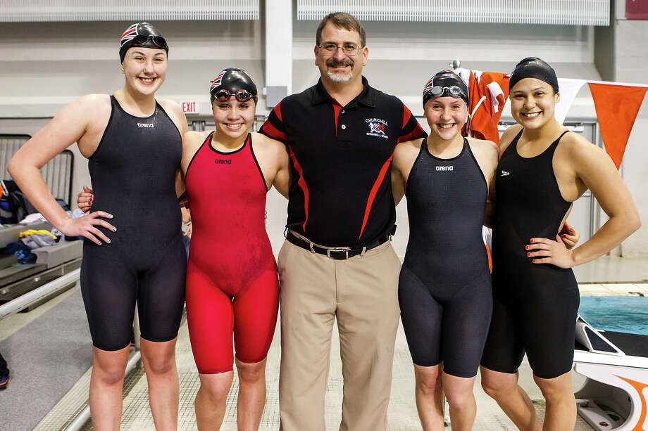 Churchill's Davina Jaynes (from left) Sophia Ridriguez, coach Mark Jedow, Haley Herzberg and Megan Strickland pose for a photo after their gold medal finish in the girls 400 yard freestyle relay in the finals of the 5A UIL Swimming & Diving State Meet at the Jamail Texas Swim Center in Austin on Saturday, Feb 23, 2013.  MARVIN PFEIFFER/ mpfeiffer@express-news.net Photo: MARVIN PFEIFFER, Express-News / Express-News 2013