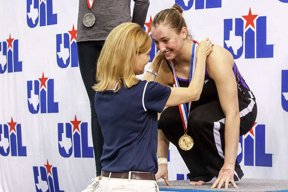 Midland's Anna James receives her gold medal for girls 1 meter diving in the finals of the 5A UIL Swimming & Diving State Meet at the Jamail Texas Swim Center in Austin on Saturday, Feb 23, 2013.  MARVIN PFEIFFER/ mpfeiffer@express-news.net Photo: MARVIN PFEIFFER, Express-News / Express-News 2013