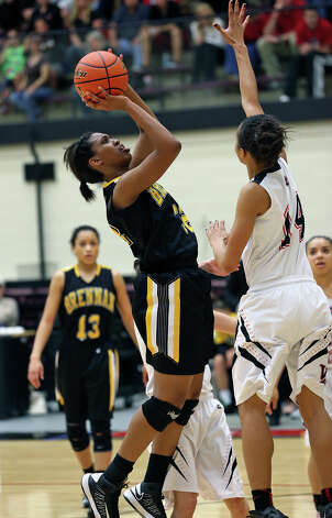 Tanaeya Boclair squares away a jumper in the lane as Brennan plays Vista Ridge in the girls Region  IV-4A championship basketball game at Littleton Gym on February 23, 2013. Photo: TOM REEL, Express-News