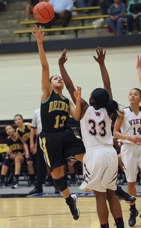 Kiara Etheridge shoots a hook in the second half as Brennan plays Vista Ridge in the girls Region  IV-4A championship basketball game at Littleton Gym on February 23, 2013. Photo: TOM REEL, Express-News