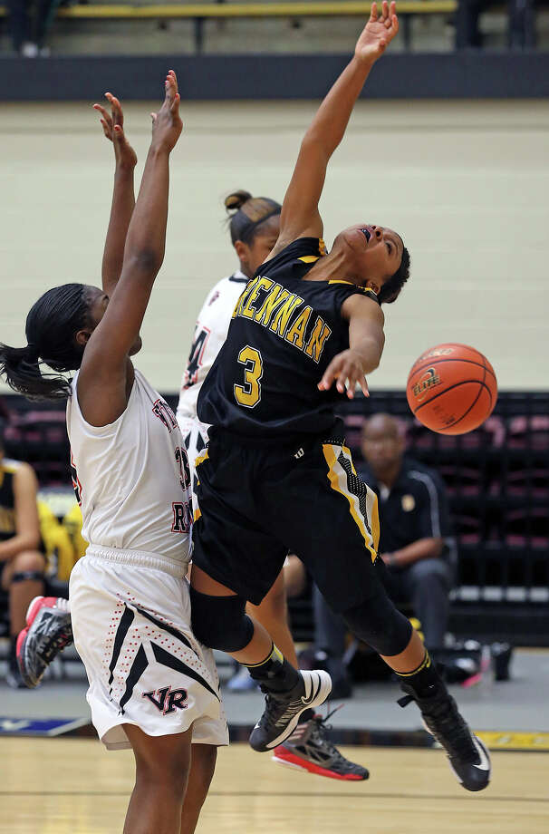 Point guard Ashlynn Graham gets pounded on a layup try in the second half as Brennan plays Vista Ridge in the girls Region  IV-4A championship basketball game at Littleton Gym on February 23, 2013. Photo: TOM REEL, Express-News