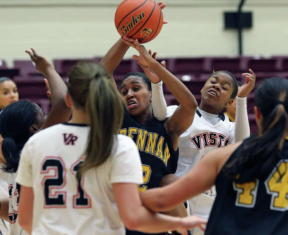 Tanaeya Boclair is fouled on an offensive rebound effort as Brennan plays Vista Ridge in the girls Region  IV-4A championship basketball game at Littleton Gym on February 23, 2013. Photo: TOM REEL, Express-News