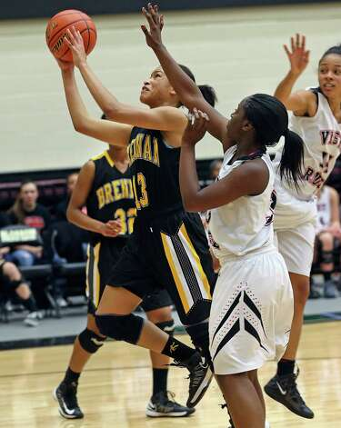 Kiara Etheridge breaks into the lane for a layup as Brennan plays Vista Ridge in the girls Region  IV-4A championship basketball game at Littleton Gym on February 23, 2013. Photo: TOM REEL, Express-News