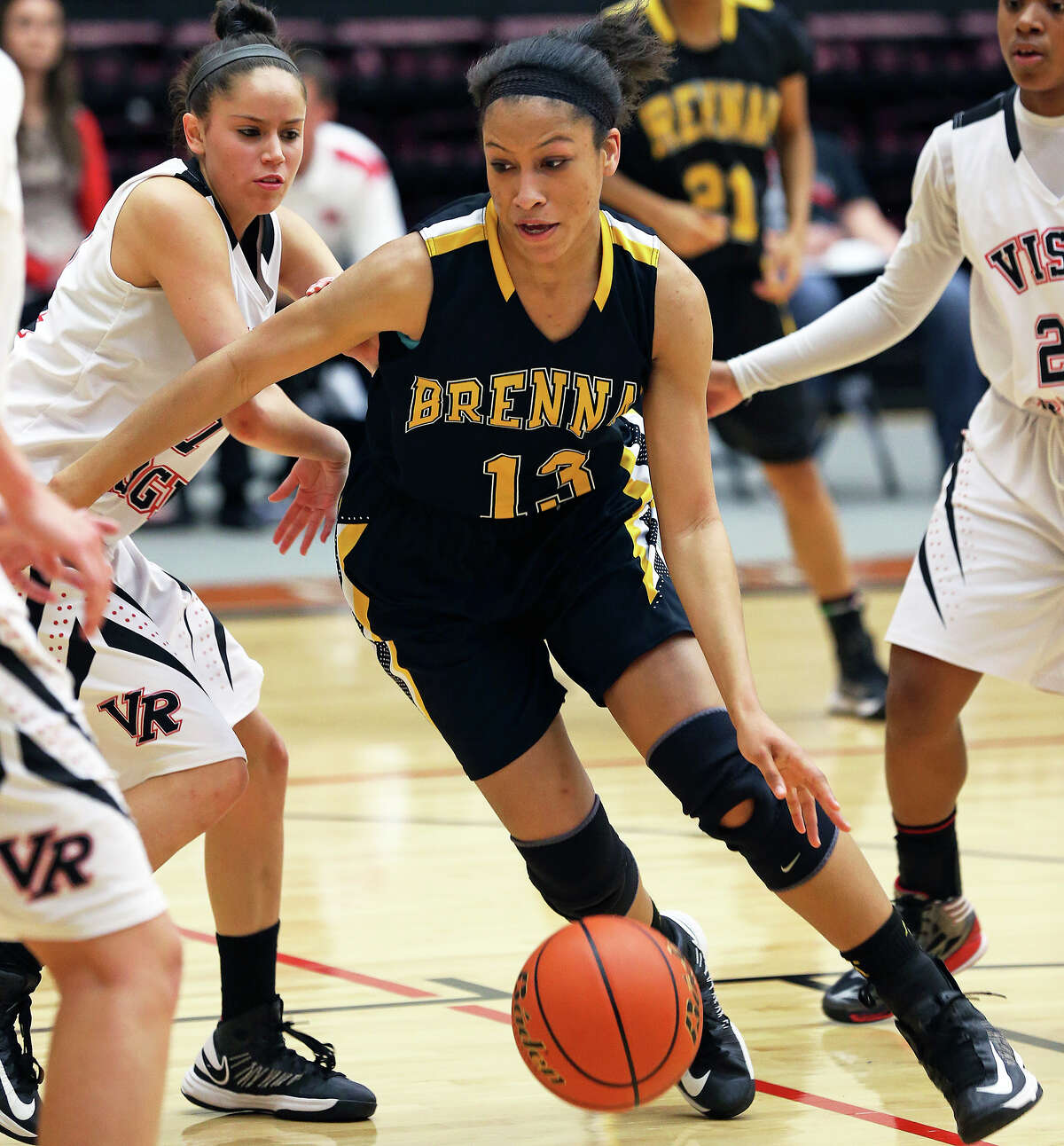 Kiara Etheridge rolls in for a shot for the Bears as Brennan plays Vista Ridge in the girls Region IV-4A championship basketball game at Littleton Gym on February 23, 2013.