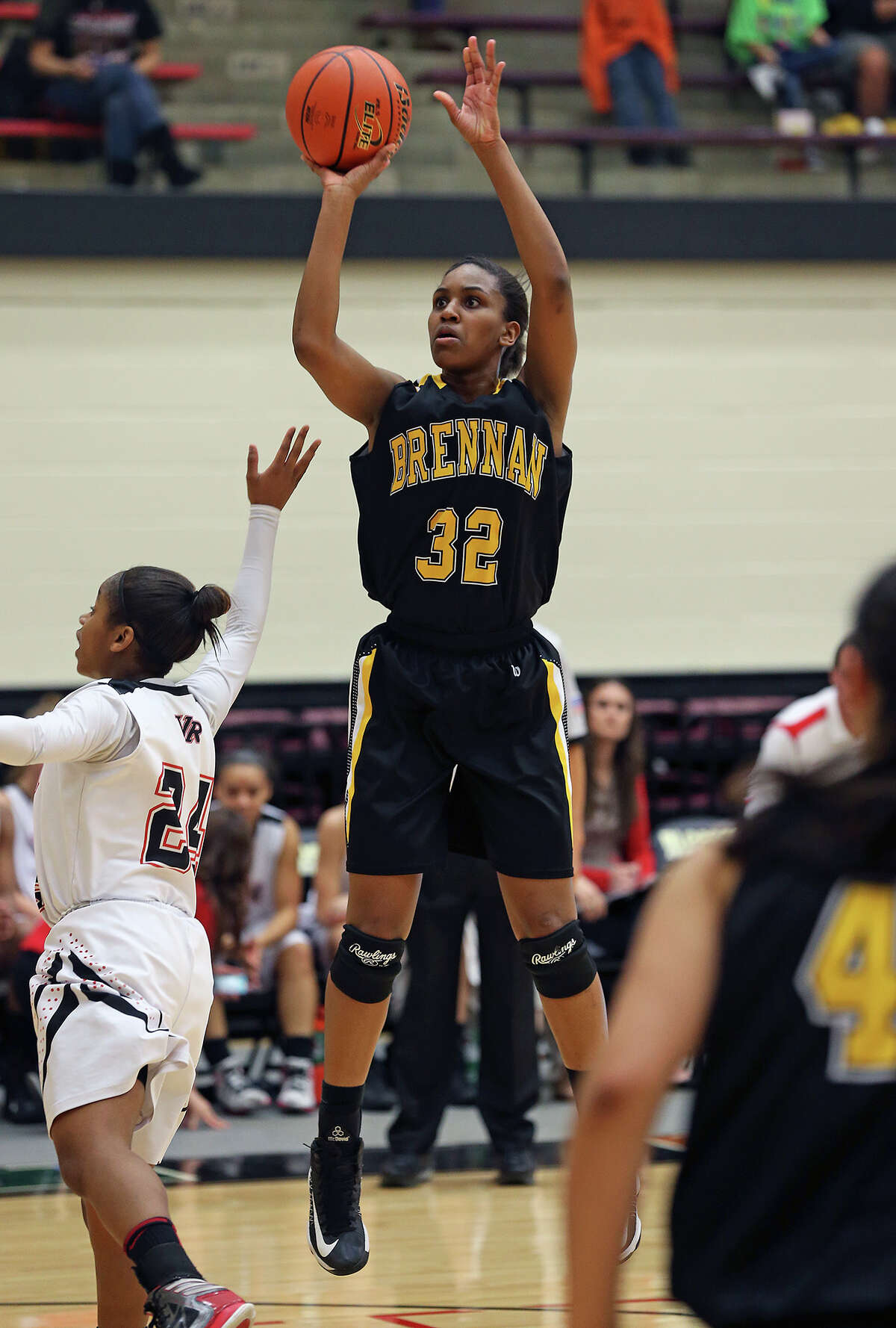 Bears forward Tanaeya Boclair pulls up for a high jumper as Brennan plays Vista Ridge in the girls Region IV-4A championship basketball game at Littleton Gym on February 23, 2013.