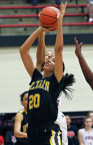 Bears center Deja Mason forces her way to the hoop as Brennan plays Vista Ridge in the girls Region  IV-4A championship basketball game at Littleton Gym on February 23, 2013. Photo: TOM REEL, Express-News