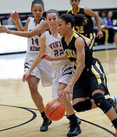Bears forward Kiara Etheridge beats Katrina Pardee (22) and Courtney Jones to the hoop as Brennan plays Vista Ridge in the girls Region  IV-4A championship basketball game at Littleton Gym on February 23, 2013. Photo: TOM REEL, Express-News