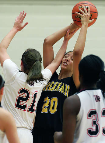 Deja Mason is fouled in the lane by Rachel Purl as Brennan plays Vista Ridge in the girls Region  IV-4A championship basketball game at Littleton Gym on February 23, 2013. Photo: TOM REEL, Express-News