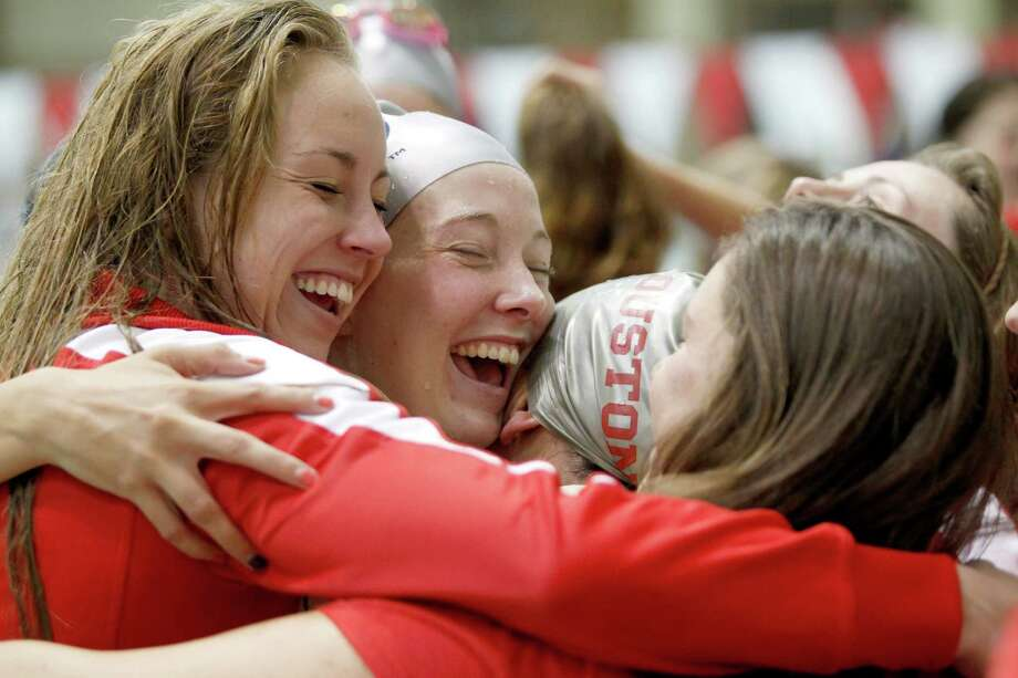 2/23/13: University of Houston swimmers from left to right Heather Winn, Maggie McCord, Holli Pisarski and Marissa Blumenthal all hug after Holli won 2nd place in the women's 200 breast stroke at the Conference USA swimming and diving championships at the University of Houston Campus and Wellness Center Natatorium in Houston, Texas. Photo: Thomas B. Shea, For The Chronicle / © 2012 Thomas B. Shea