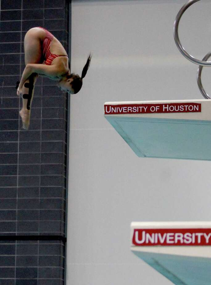 2/23/13: University of Houstons Natasha Burgess dives at the Conference USA swimming and diving championships at the University of Houston Campus and Wellness Center Natatorium in Houston, Texas. The university of Houston women swept the platform diving. Julia Lonnegren was 1st, Natasha Burgess was 2nd and Danielle Shedd was 3rd Photo: Thomas B. Shea, For The Chronicle / © 2012 Thomas B. Shea