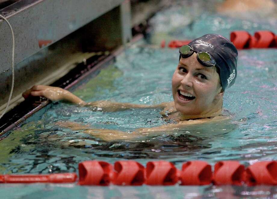 2/23/13:  Rice Erin Flanigan smiles at the finish after winning the 1650 yard freestyle with a time of 16:54:97 at the Conference USA swimming and diving championships at the University of Houston Campus and Wellness Center Natatorium in Houston, Texas. Photo: Thomas B. Shea, For The Chronicle / © 2012 Thomas B. Shea