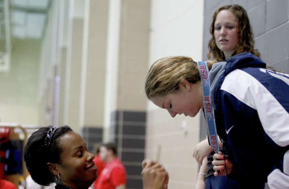 2/23/13:  Rice Erin Flanigan receives her gild medal after she won the 1650 yard freestyle with a time of 16:54:97 at the Conference USA swimming and diving championships at the University of Houston Campus and Wellness Center Natatorium in Houston, Texas. Photo: Thomas B. Shea, For The Chronicle / © 2012 Thomas B. Shea