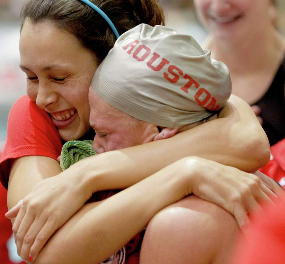 2/23/13: University of Houston Lauren Spano hugs Holli Pisarski after Holli won 2nd place in the women's 200 breast stroke at the Conference USA swimming and diving championships at the University of Houston Campus and Wellness Center Natatorium in Houston, Texas. Photo: Thomas B. Shea, For The Chronicle / © 2012 Thomas B. Shea