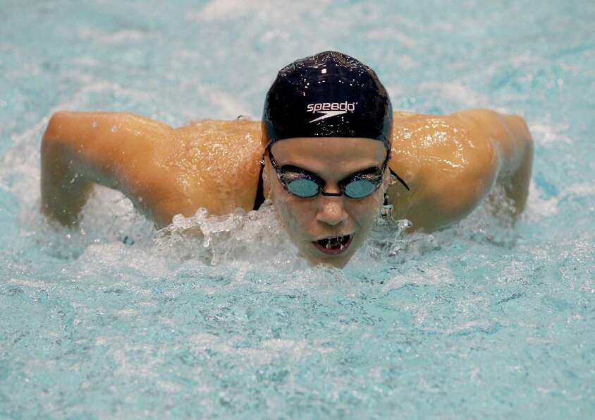 2/23/13: Rice Chelsea Fong competes in the butterfly at the Conference USA swimming and diving champ