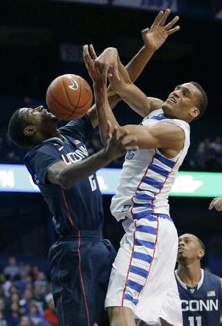 Connecticut forward DeAndre Daniels, left, blocks a shot by DePaul forward Cleveland Melvin during the second half of an NCAA college basketball game in Rosemont, Ill., on Saturday, Feb. 23, 2013. Connecticut won 81-69. (AP Photo/Nam Y. Huh) Photo: Nam Y. Huh, Associated Press / AP