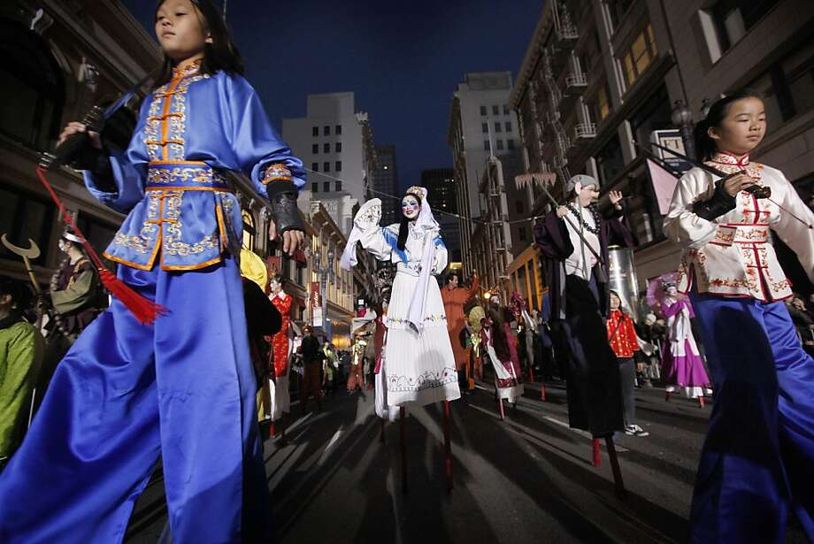 Mayra Chang, (center) dressed as the Goddess of Mercy walks on stilts as San Francisco's Chinese New Year parade makes it's way through downtown on Saturday Feb. 23, 2013. Photo: Michael Macor, The Chronicle