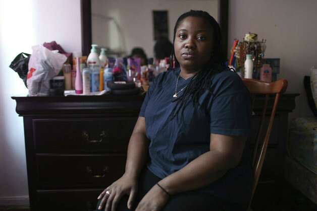 Brooklyn resident Subrina Baptiste took out two online loans, only to have her bank allow the lenders to seize her child-support funds to cover overdraft fees. Photo: Michelle V. Agins / New York Times