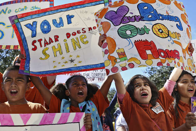 "John Estrada, 9 (from left); Marlee Foster, 10; Maricarmen Marquez, 9; and Anastacia Ortega, 9, chant, ""Save our schools!"" as they march toward the Capitol. All the kids are in fourth grade at UT Elementary School in Austin."