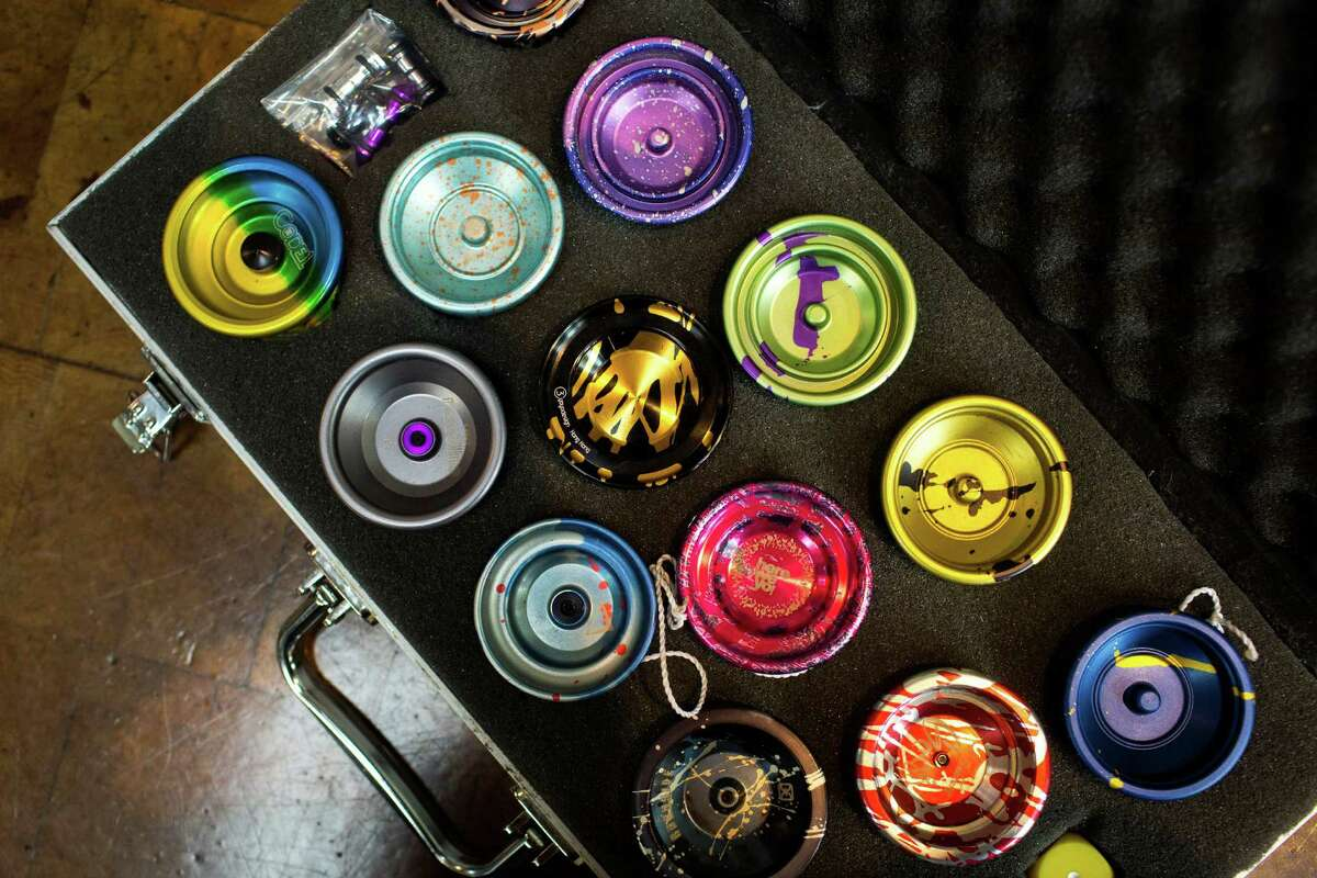 A colorful variety of high-performance yo-yos sit on display in a traveler's case.