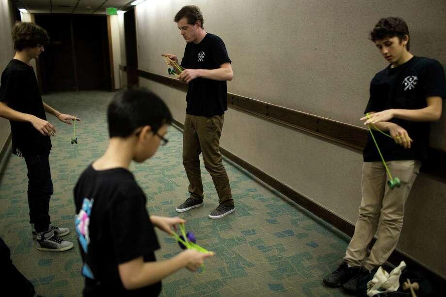 Champion yo-yo players warm up in a quiet hallway. Photo: JORDAN STEAD / SEATTLEPI.COM