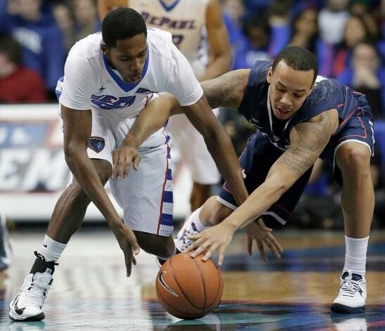 DePaul guard Durrell McDonald, left, and Connecticut guard Shabazz Napier reach for a loose ball during the second half of an NCAA college basketball game in Rosemont, Ill., on Saturday, Feb. 23, 2013. Connecticut won 81-69. (AP Photo/Nam Y. Huh) Photo: Nam Y. Huh, Associated Press / AP