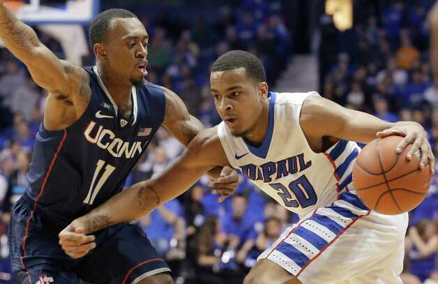 Connecticut guard Ryan Boatright, left, defends DePaul guard Brandon Young during the second half of an NCAA college basketball game in Rosemont, Ill., on Saturday, Feb. 23, 2013. Connecticut won 81-69. (AP Photo/Nam Y. Huh) Photo: Nam Y. Huh, Associated Press / AP