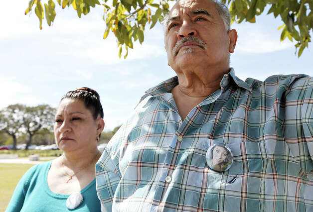Rudy Rivera Jr. and his wife, Jessica, attend his niece's grave- side service. The funeral procession from the church, which is less than seven miles from the cemetery, took 45 minutes.