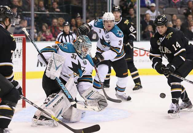 DALLAS, TX - FEBRUARY 23:  Antti Niemi #31 of the San Jose Sharks makes a save against Jamie Benn #14 of the Dallas Stars at American Airlines Center on February 23, 2013 in Dallas, Texas.  (Photo by Ronald Martinez/Getty Images) Photo: Ronald Martinez, Getty Images