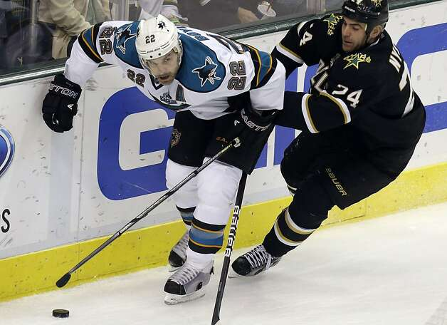 San Jose Sharks defenseman Dan Boyle (22) and Dallas Stars left wing Eric Nystrom (24) skate for the puck during the first period of an NHL hockey game, Saturday, Feb. 23, 2013, in Dallas. (AP Photo/LM Otero) Photo: LM Otero, Associated Press