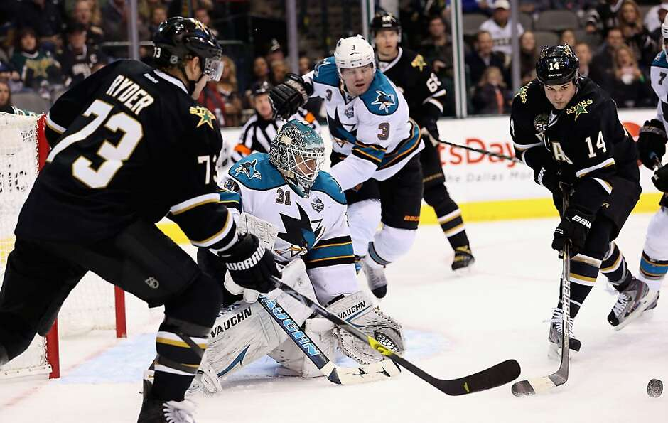 DALLAS, TX - FEBRUARY 23:  Antti Niemi #31 of the San Jose Sharks makes a save against Jamie Benn #1