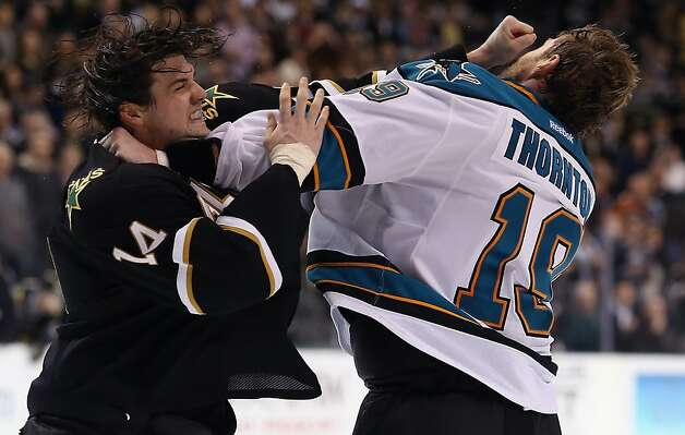 DALLAS, TX - FEBRUARY 23:  (L-R) Jamie Benn #14 of the Dallas Stars fights with Joe Thornton #19 of the San Jose Sharks at American Airlines Center on February 23, 2013 in Dallas, Texas.  (Photo by Ronald Martinez/Getty Images) Photo: Ronald Martinez, Getty Images
