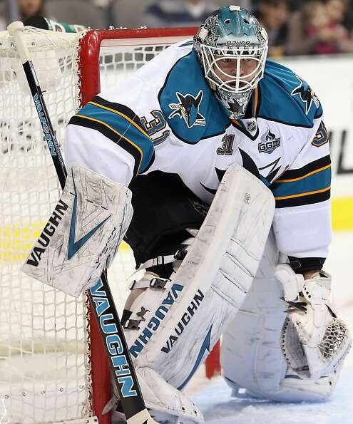 DALLAS, TX - FEBRUARY 23:  Antti Niemi #31 of the San Jose Sharks in goal against the Dallas Stars a