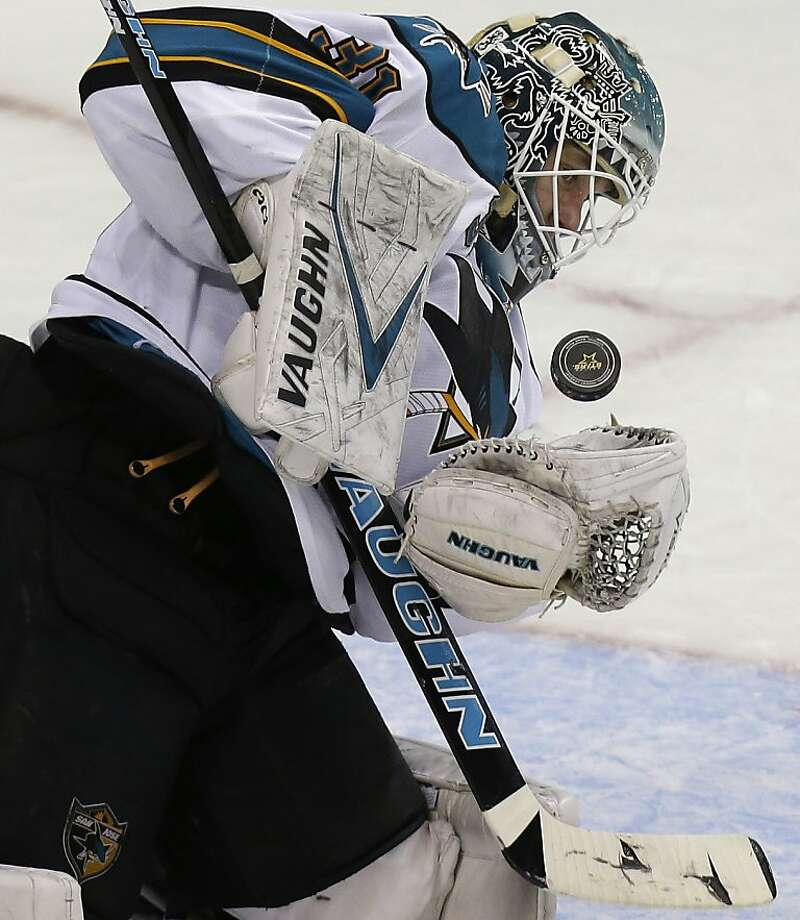 San Jose Sharks goalie Antti Niemi (31), of Finland, blocks a shot during the first period of an NHL hockey game against the Dallas Stars, Saturday, Feb. 23, 2013, in Dallas. (AP Photo/LM Otero) Photo: LM Otero, Associated Press