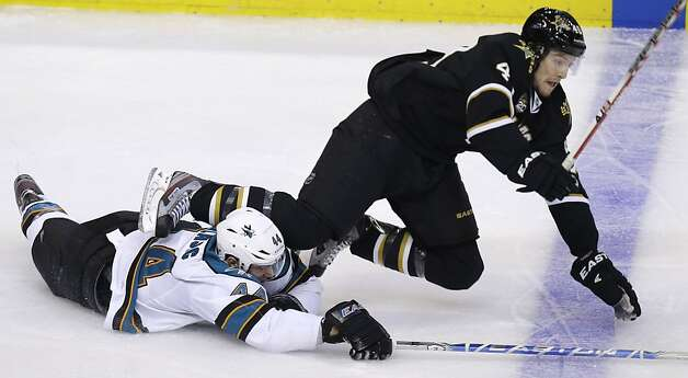 San Jose Sharks defenseman Marc-Edouard Vlasic (44) trips Dallas Stars defenseman Brenden Dillon (4) during the second period of an NHL hockey game, Saturday, Feb. 23, 2013, in Dallas. A penalty was called on Marc-Edouard Vlasic for the play. (AP Photo/LM Otero) Photo: LM Otero, Associated Press