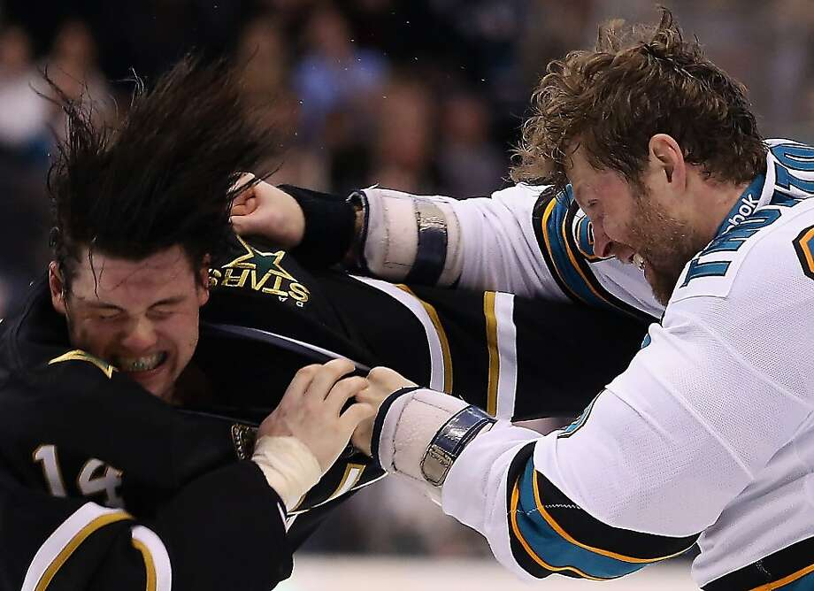 The Stars' Jamie Benn (left), who scored the final goal of the game, fights the Sharks' Joe Thornton in the second period. Photo: Ronald Martinez, Getty Images