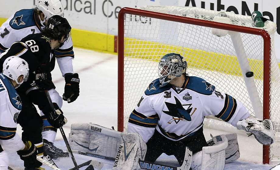 Dallas Stars right wing Jaromir Jagr (68) scores a goal against San Jose Sharks goalie Antti Niemi (31) as Brad Stuart (7) and Joe Pavelski (8) look on during the second period of an NHL hockey game Saturday, Feb. 23, 2013, in Dallas. (AP Photo/LM Otero) Photo: LM Otero, Associated Press