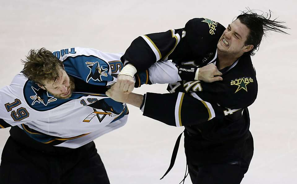San Jose Sharks center Joe Thornton (19) and Dallas Stars left wing Jamie Benn (14) fight during the