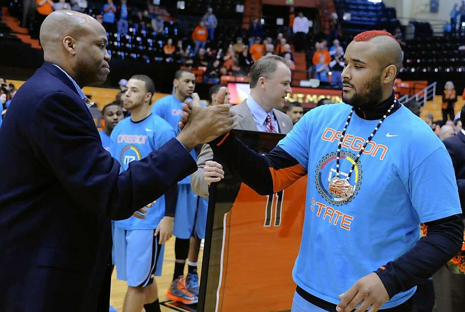Oregon State senior Joe Burton, right, is greeted by coach Craig Robinson before an NCAA college basketball game against California in Corvallis, Ore., Saturday, Feb. 23, 2013. (AP Photo/Greg Wahl-Stephens) Photo: Greg Wahl-Stephens, Associated Press