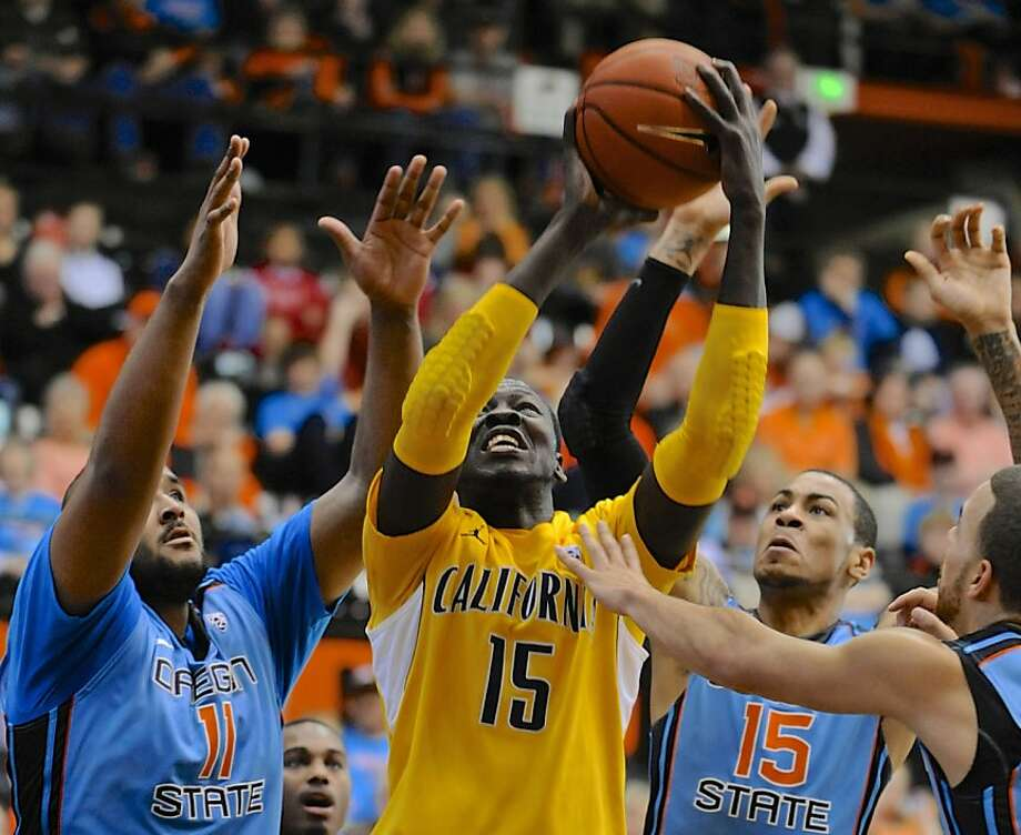 Oregon State's Joe Burton (11) and Eric Moreland (15) defend a shot by California's Bak Bak (15) during the first half of an NCAA college basketball game in Corvallis, Ore., Saturday, Feb. 23, 2013. California edged Oregon State, 60-59. (AP Photo/Greg Wahl-Stephens) Photo: Greg Wahl-Stephens, Associated Press