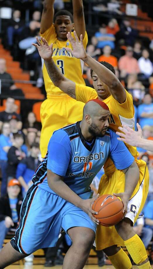 California's Richard Solomon defends against Oregon State's Joe Burton (11) during the first half of an NCAA college basketball game in Corvallis, Ore., Saturday, Feb. 23, 2013. (AP Photo/Greg Wahl-Stephens) Photo: Greg Wahl-Stephens, Associated Press