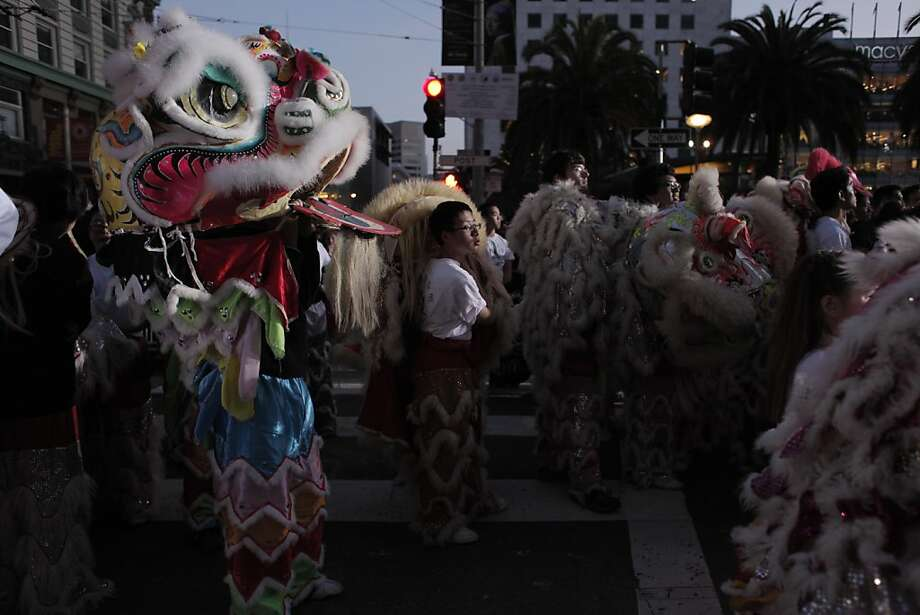 Parade participants rest near Union Square during the Chinese New Year Parade on Saturday, Feb. 23. Photo: James Tensuan, The Chronicle