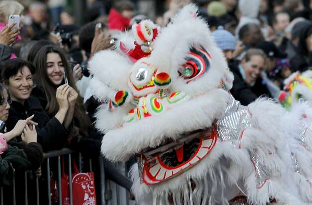 The West Portal Elementary School Lion Dancers entertain the crowd as San Francisco's Chinese New Year parade makes it's way through downtown on Saturday Feb. 23, 2013. Photo: Michael Macor, The Chronicle
