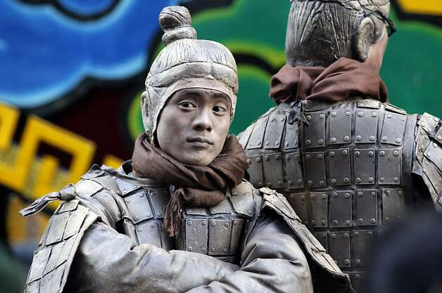Calvin Ku dressed as a Terra Cotta Warriors to promote the Asian Art Museum strikes a pose as San Francisco's Chinese New Year parade makes it's way through downtown on Saturday Feb. 23, 2013. Photo: Michael Macor, The Chronicle