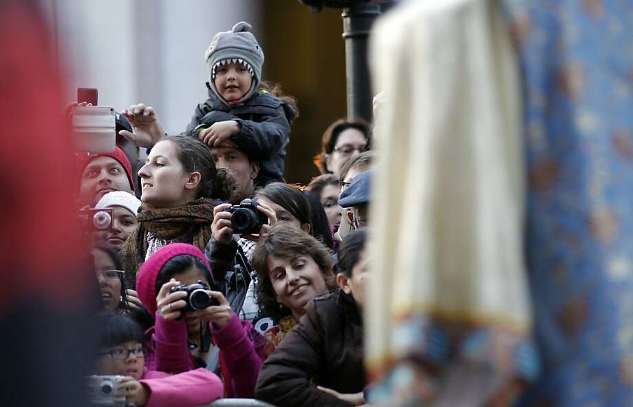 Smiles from the crowd as San Francisco's Chinese New Year parade makes it's way through downtown on Saturday Feb. 23, 2013. Photo: Michael Macor, The Chronicle