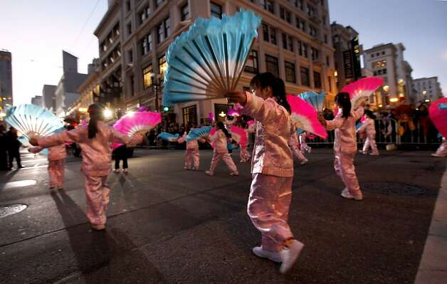 Children move along as San Francisco's Chinese New Year parade makes it's way through downtown on Saturday Feb. 23, 2013. Photo: Michael Macor, The Chronicle